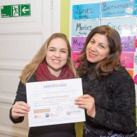 Student with her certificate, Tandem Santiago
